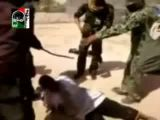Brutal treatment of a rebel in the Libyan