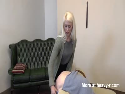 Strict Lady administers the strap