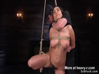 Busty hairy slave fucked with dick on a stick