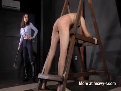 Brunette Mistress Whipping Slave