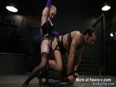 Dominant slut torments muscular slave