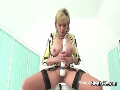 Busty Lady Vibrating Her Clit