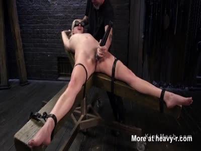 Blonde Flogged On Back Arched Bondage Device