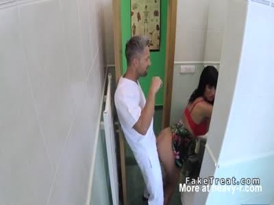 Doctor bangs huge fake tits patient