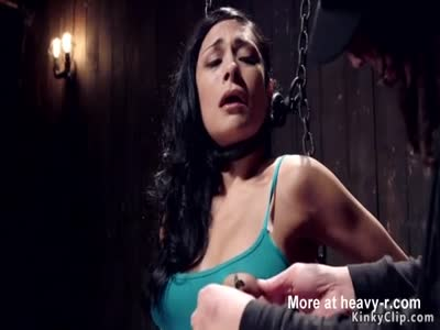 Brunette beauty caned in dungeon bondage