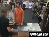 Horny hunk tugging on his cock at the pawn shop
