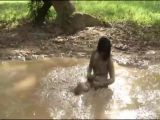 Girl Takes Mud Bath