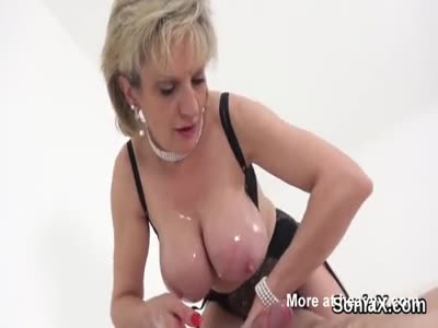 Handjob By Oiled Busty Lady