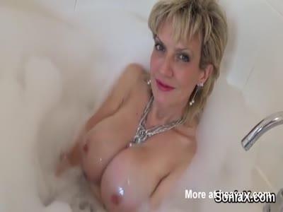 Busty Milf Bathing