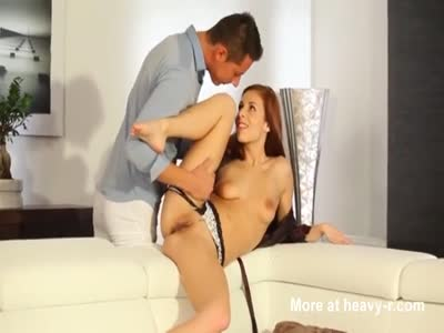 Skinny redhead fucked on couch