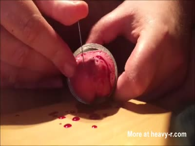 Piercing Throbbing Cock With Needle