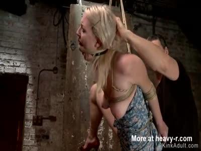 Blonde slave is tormented in hogtie