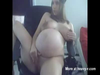 Preggo Slut Rubbing Her Cunt