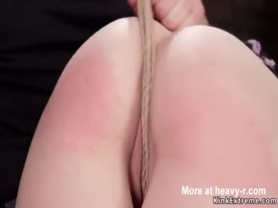 Slave in crotch rope bondage gets spanked