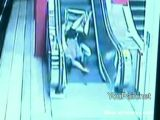 Handicapped Woman Rolls Down Escalator