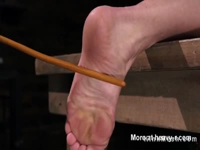 Caning In Bondage Device