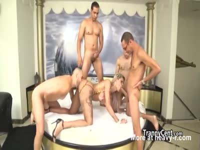 Blonde tranny sucking four big cock