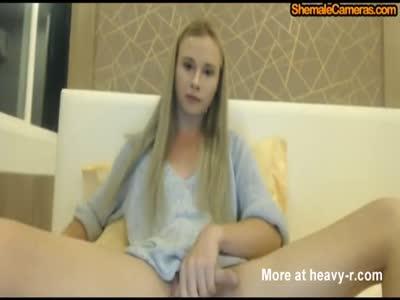 Blonde trans masturbates her dick