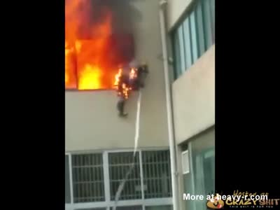 Fireman Caught On Fire Jumps From Window
