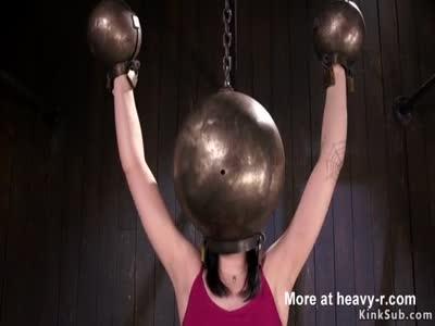 Slut with huge metal ball on her head