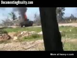 Rebel Throws a Grenade Down a Tank Barrel