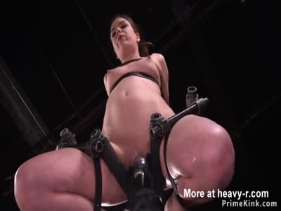Brunette pussy lips tormented in device