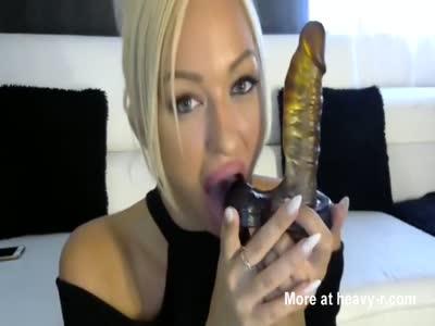 Blonde dirty talking and sucking dildo