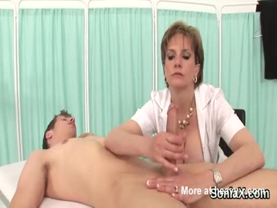 Busty Lady Giving Handjob