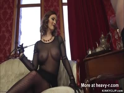 Femdom MILF whips man in chastity
