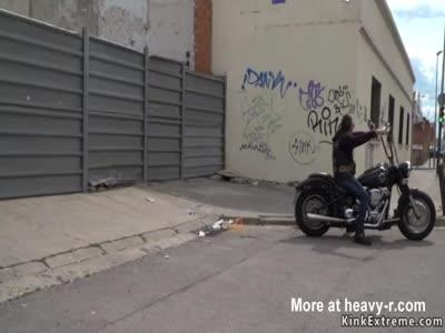 Brunette serves bikers in shop