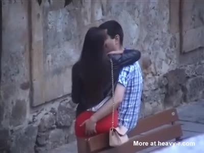 Spanish couple kissing on the street