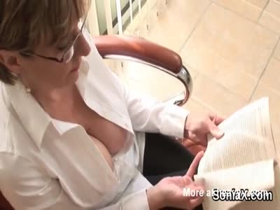 Big Knockers On A MILF Wearing Glasses