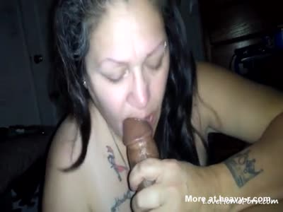 Busty ebony sucking dick