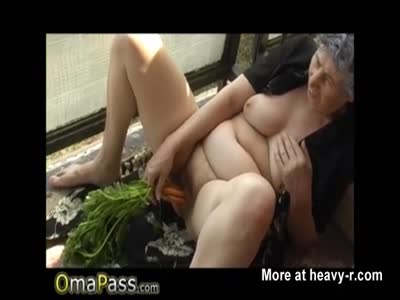 Granny Inserting Veggies On Balcony