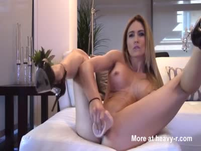 Leggy Babe Masturbating With Fake Cock