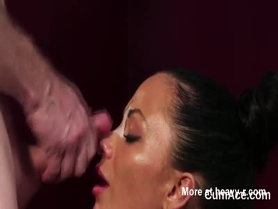 Horny looker gets cumshot on her face eating all the juice