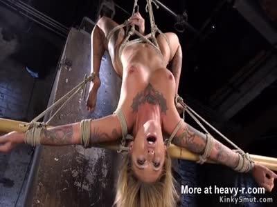 Alt busty blonde in strict hogtie suspension