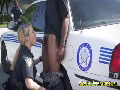 Suspect gets sucked off in public by horny milf cops