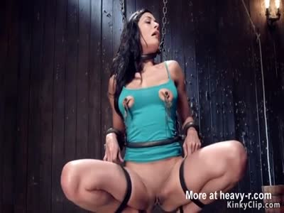 Busty brunette sub chained and vibrated
