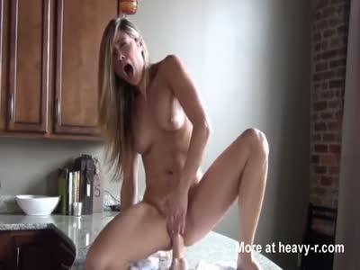 Blonde dildo ridding in kitchen