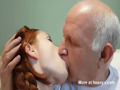 Old man kissing young sexy redhead