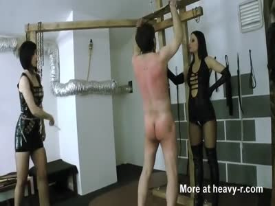 Two young ladies whipping male slave