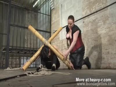 Submissive In Bamboo Bondage