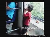 Kid hangs out of moving train
