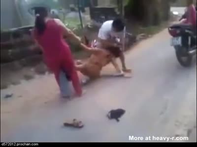 In asia a couple beat a girl in street and naked her