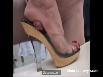 Squeezing Cock With Heel