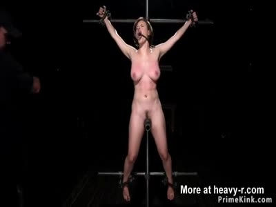 Busty in device bondage takes bastinado
