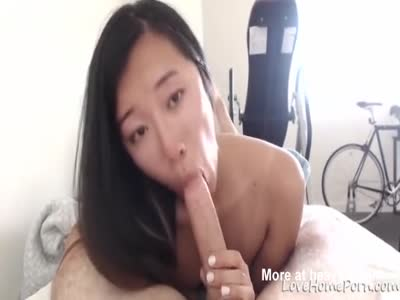 Watch my amateur Asian girlfriend gobbling a dick