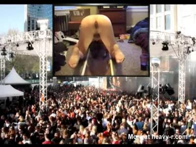 Outdoor public pooping on a video screen by Mark Heffron