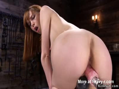 Redhead rides fucking machine and Sybian
